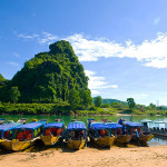 Walk to boat whraf and take a pleasant boat trip to Phong Nha Cave