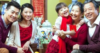 Three generations of Vietnamese people in Tet