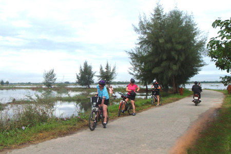 Cycling through the passes to Lang Co beach, Hue