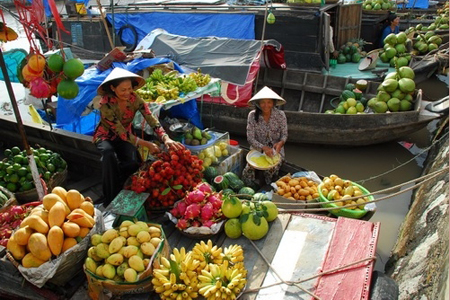 Fruits on boat in Cai Rang Floating Market