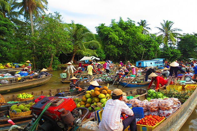 cai be floating market ho chi minh city tour package