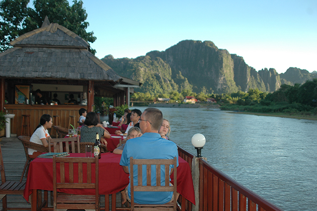 meal beside the river in vang vieng