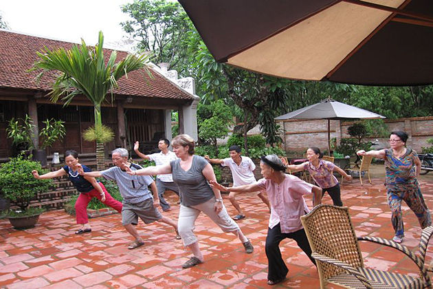 morning exercise at moon garden homestay north vietnam tour