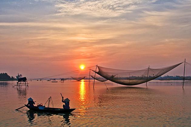 the sunset at cua dai beach