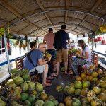 cai be floating market vietnam laos tour