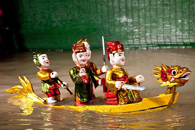 water puppet show in hanoi vietnam laos tour
