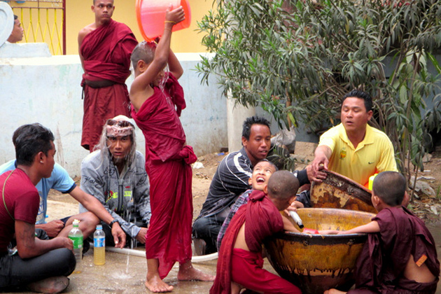 Little monks splashing water in Myanmar Thingyan Festival