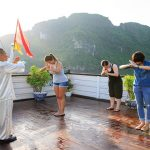halong bay tai chi lession in the morning